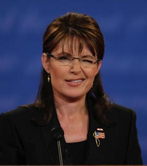 Palin winkling and survives debate with folksy style